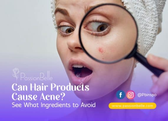 Woman looking at acne spot on her face from hair products that cause acne